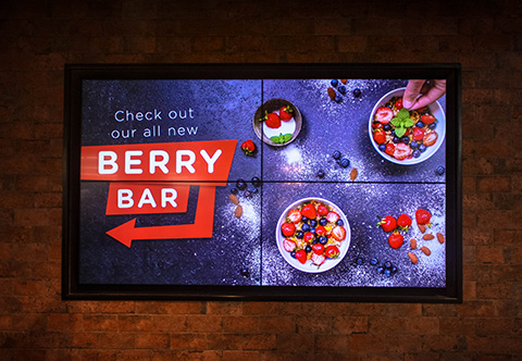 Two by two video wall displaying content at Foodland Brighton